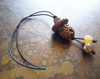 Natural Elements Agate Acrylic Wood and Obsidian Hair Tie