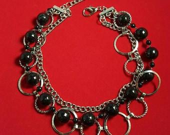 Multi strand statement  bracelet featuring a black bead strand