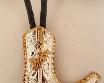 Western wear boot   jockeying bull  bolo tie.