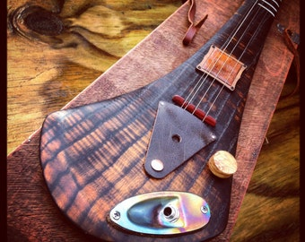 Handcrafted electric guitar by DaShtick guitars. 4 string Celtic diddley bow. CBG