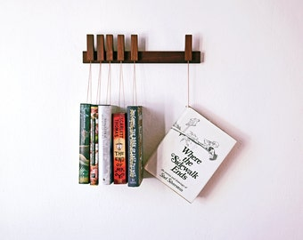 Custom made wooden book rack in Walnut. Pins also work as bookmarks. Bookshelf. Bookcase