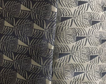 Bluish gray reversible fabric remnant with triangles cones motif