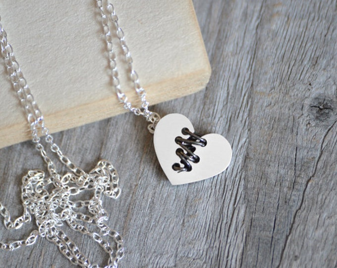 Mended Heart Necklace With Black Silver Sutures, Handmade In The UK