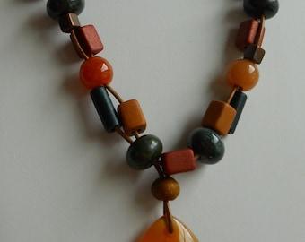 Carnelian teardrop stone pendant and beaded leather necklace