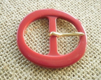 Plastic Red Oval belt buckle, size 4.5/5 cm