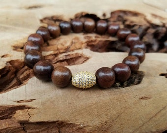 Stackable Magkuno Natural Wood Stretch Bracelet With A Gold Micro Pave CZ Oval Bead