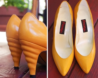 Yellow OCHRE 1980's 90's Vintage Bright Yellow Leather High Heels Pumps w/ Wavy Back Heels // by PROXY // size 5.5 M