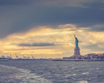 Colour photograph of the Statue of Liberty at sunset