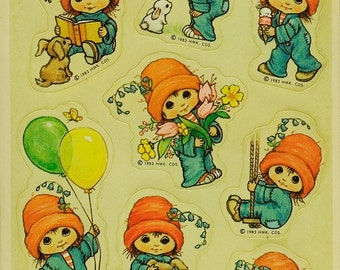 Cute little girl in orange hat vintage Hallmark stickers, 1983