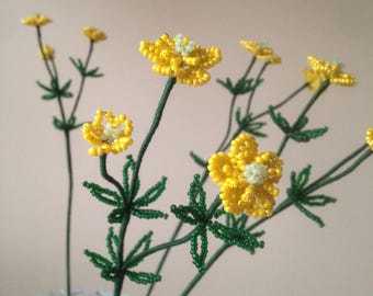 Yellow buttercup made of beads