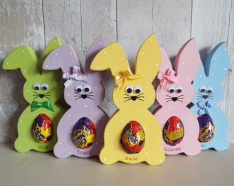PERSONALISED EASTER BUNNY - holds a creme egg (or similar) in its tummy. Can be made with any name. Hand-painted, free-standing. 20cm tall.