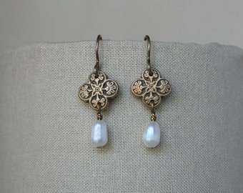 Antiqued Bronze and pearl dangle earrings.