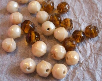 Assorted amber and cream plastic beads