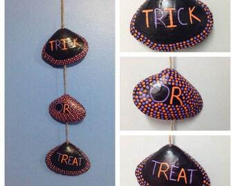 Hand painted Halloween seashells. Trick or treat decor. Wall hanging