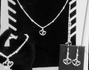 Entwined heart charm jewellery
