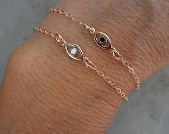 Bracelet oeil or rose avec une touche d'émail avec chaîne en plaqué or rose