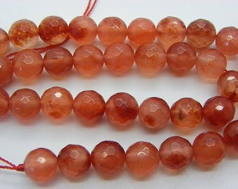 38 jade beads faceted 10 mm with a rust orange transparent 1st choice