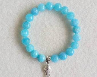 Aquamarine stretch bracelet with charm