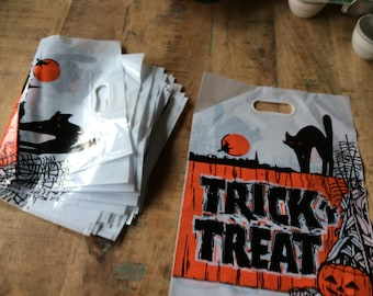 Lot of 9 vintage plastic Halloween trick or treat bags with built in handle