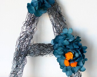 Wire letter with natural flowers preserved love in shades of blue and oranges