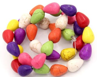 A set of 7 beads Holwite of yellow, orange, red, purple, ivory, pink, green.