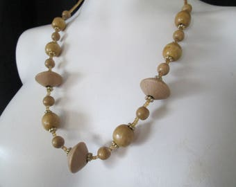 """Hand carved wood and amber glass beaded necklace measures 24"""" long"""