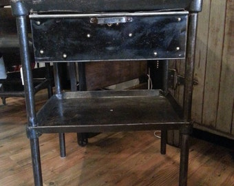 Vintage industrial cast iron turtle table with drawer