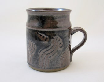 Stoneware temmoku mugs, wheel-thrown and hand-carved