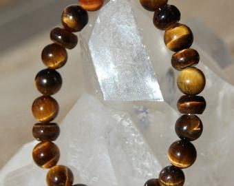 bracelet avec perles et rondelles  en oeil de tigre