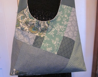 Patchwork green  cross body bag, fully lined, inside pockets, washable, reinforced corners,made to last, comfort strap.