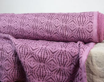 Pure 100% linen fabric 200gsm. Abstract brownish purple pattern on pale pink-purplish base. Middle weight, washed-softened. For clothes.