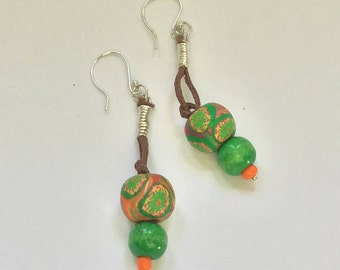 Boho beaded earrings in greens and orange