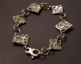 Swirls Fine Silver and Sterling Silver Bracelet. Precious Metal Clay 3, Stamped with Swirls, connected w/ Sterling Silver jump rings & clasp