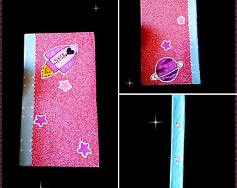 paper notebook with spaceship