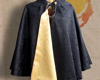 Small yellow and black reversible cape