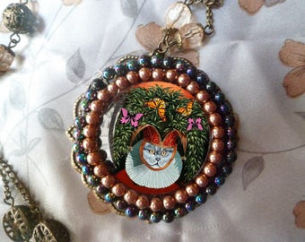 large baroque necklace with round and portrait of cat: cat dressed in jester