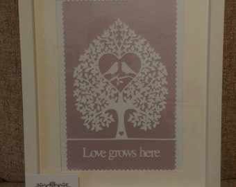 Framed love grows here paper cut
