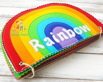 Rainbow colorful handmade quiet book with interactive pages