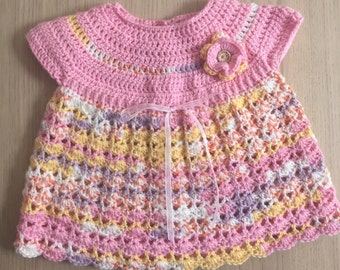 Baby dress with ribbon and flower