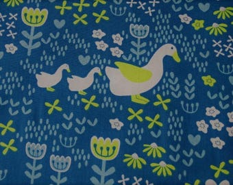 Printed cotton fabric patterns of geese on teal background
