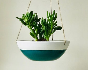 Green and white hanging ceramic planter