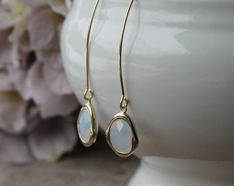 Gold plated marquise hook and white opal glass dangle earrings