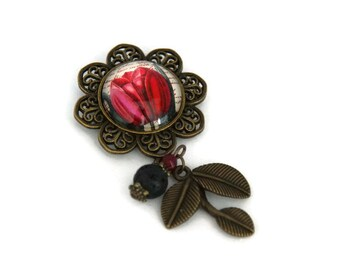 Floral brooch, fuchsia beads and black, and foliage