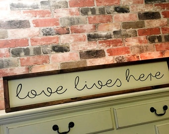 Love lives here painted wood sign