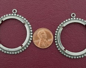 two antiqued silver plated 50 cent coin mounting