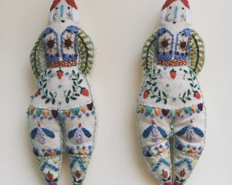 Hand embroidered doll