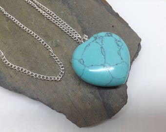 A gorgeous large turquoise heart pendant necklace.