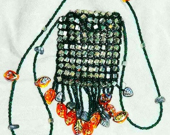 green and silver amulet bag with topaz leaves