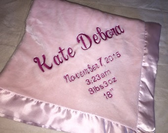 Personalized embroidered baby blanket with satin trim
