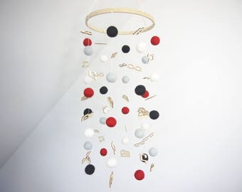 Black, white, red and grey felt ball baby mobile with wood embellishments